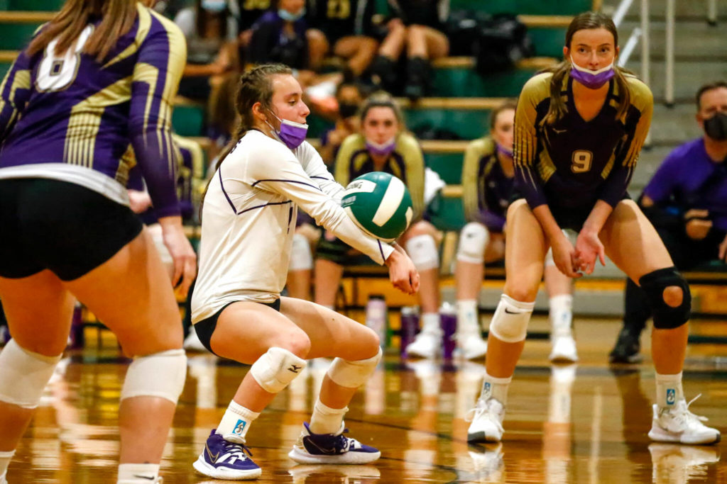 Lake Stevens' Kennedy Steen digs against Lake Stevens' Tuesday night at Edmonds-Woodway High School in Edmonds on September 7, 2021. The Vikings won in straight sets. (Kevin Clark / The Herald)