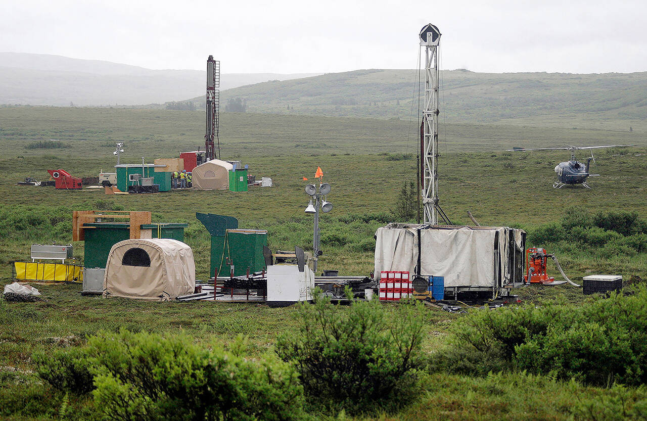 In this 2007 photo, workers with the Pebble Mine project test drill in the Bristol Bay region of Alaska, near the village of Iliamma. (AP Photo/Al Grillo, File)