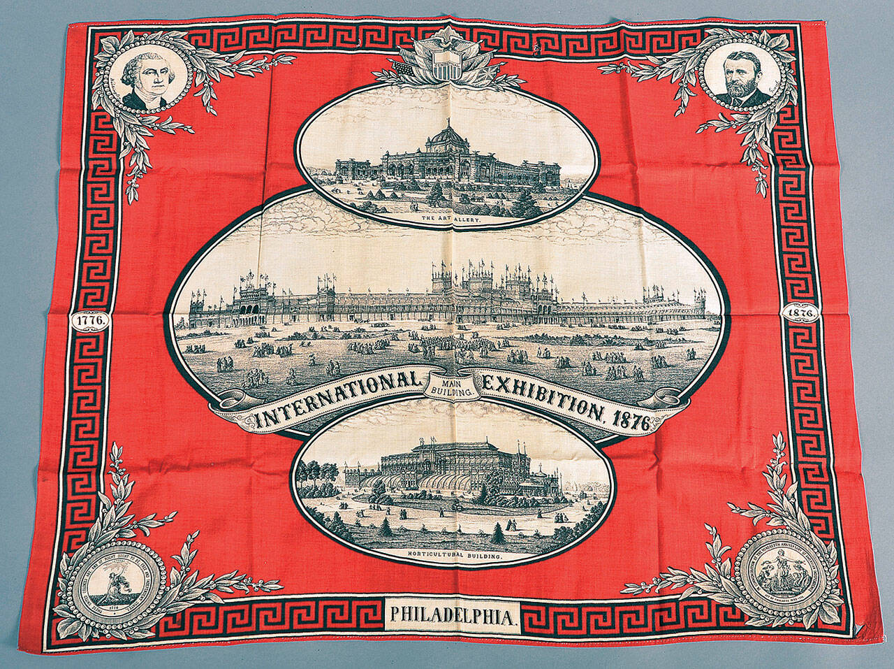 This Centennial Exhibition handkerchief with portraits of Washington and Grant and pictures of exhibition buildings is 22 inches by 28 inches and sold at Conestoga Auction Co. for $70. (Cowles Syndicate Inc.)