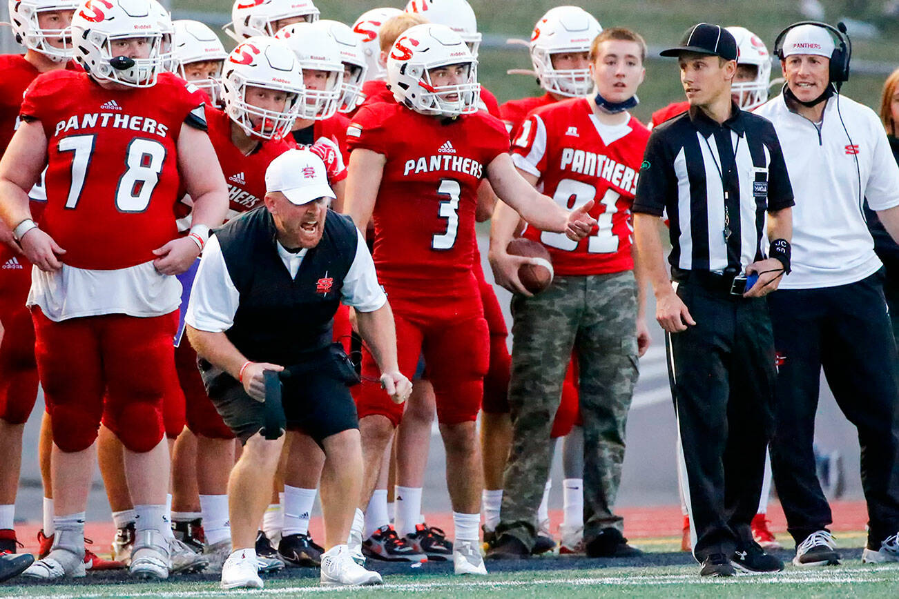 Snohomish's Joey Hammer, head coach, reacts to a call on the field Friday night at Veteran's Memorial Stadium in Snohomish September 3, 2021. (Kevin Clark / The Herald)