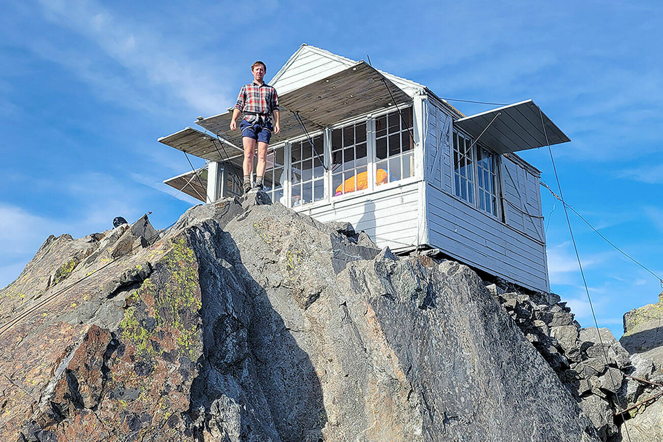 Zach Graham stands in front of a newly restored Three Fingers Lookout. (Friends of Three Fingers Lookout)