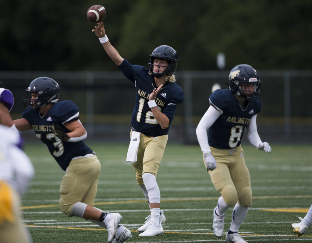 Arlington's Trent Nobach throws the ball during the game against Oak Harbor on Friday, Sept. 10, 2021 in Arlington, Wa. (Olivia Vanni / The Herald)