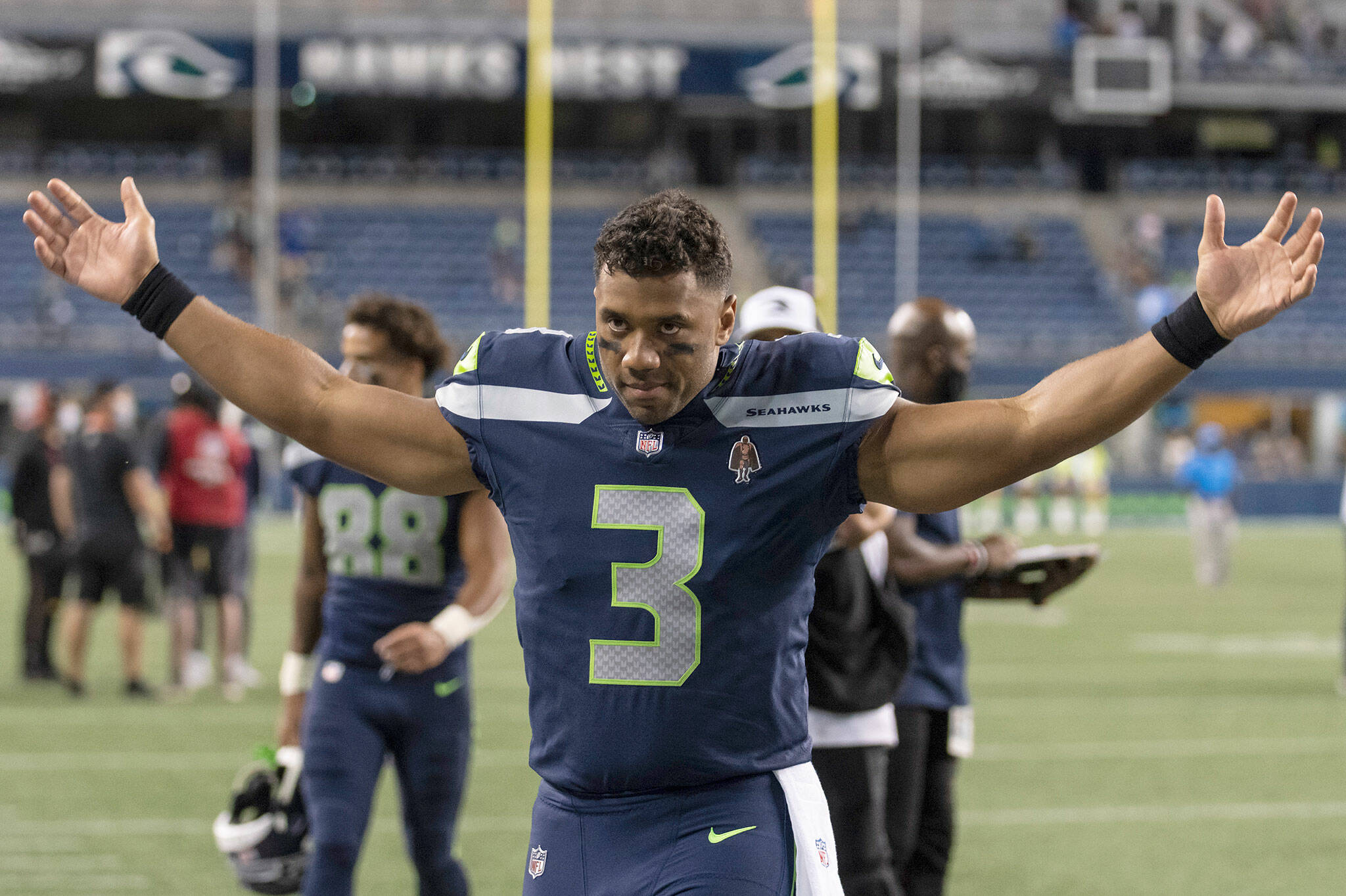 Seahawks quarterback Russell Wilson gestures as he walks off the field after a preseason game against the Chargers on Aug. 28, 2021, in Seattle. (AP Photo/Stephen Brashear)