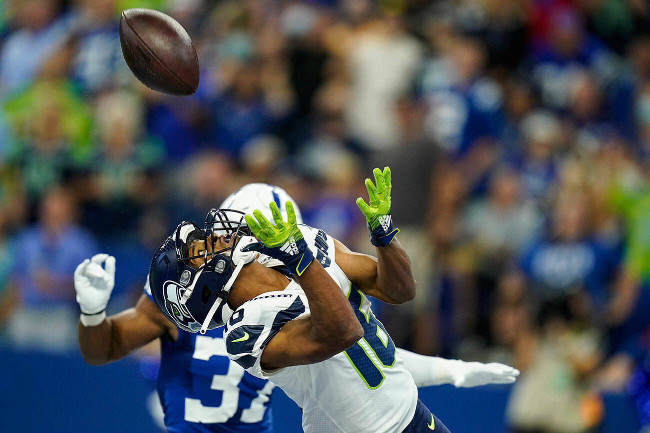 Seattle Seahawks wide receiver Tyler Lockett (16) makes catch for a touchdown against the Indianapolis Colts in the first half of an NFL football game in Indianapolis, Sunday, Sept. 12, 2021. (AP Photo/Charlie Neibergall)