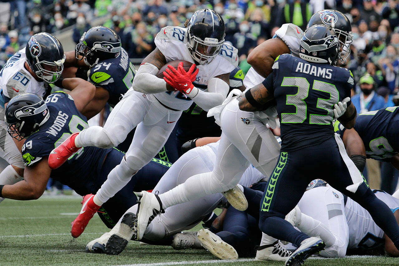 Tennessee Titans running back Derrick Henry (22) scores a touchdown against the Seattle Seahawks during the second half of Sunday's game in Seattle. (AP Photo/John Froschauer)