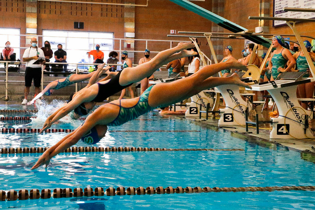 The start of the 400 yard freestyle relay Tuesday afternoon at Kamiak High School in Mukilteo on September 21, 2021. (Kevin Clark / The Herald)