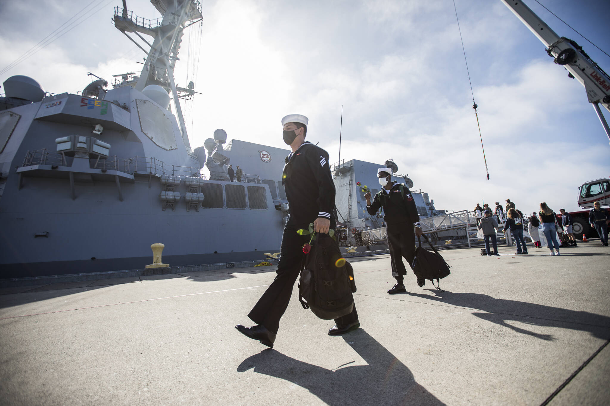 Sailors disembark the USS Kidd after returning from deployment on Friday in Everett. (Olivia Vanni / The Herald)