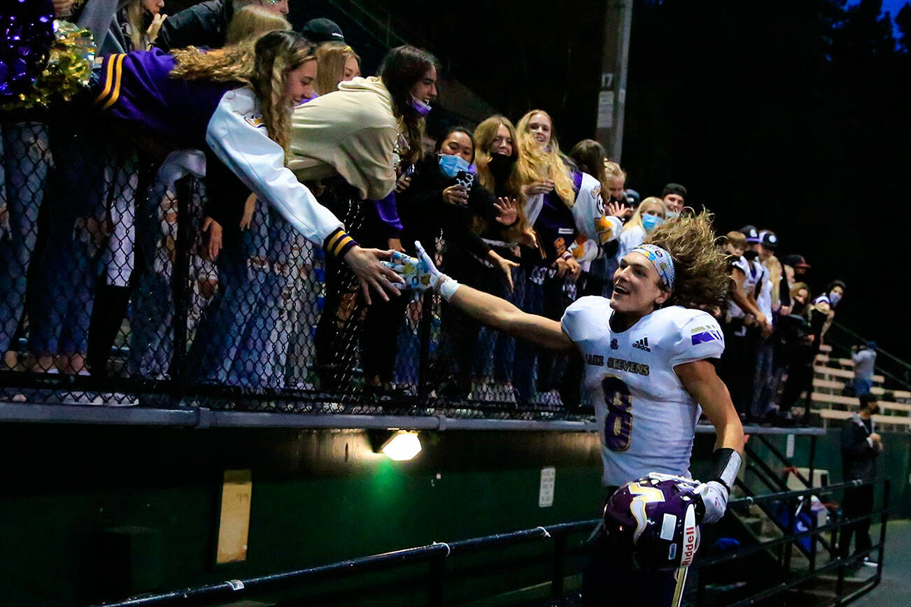 Lake Stevens' Drew Carter celebrates with the fans Friday at Memorial Stadium in Seattle on September 17, 2021. The Vikings defeated the Irish, 20-3. (Kevin Clark / The Herald)