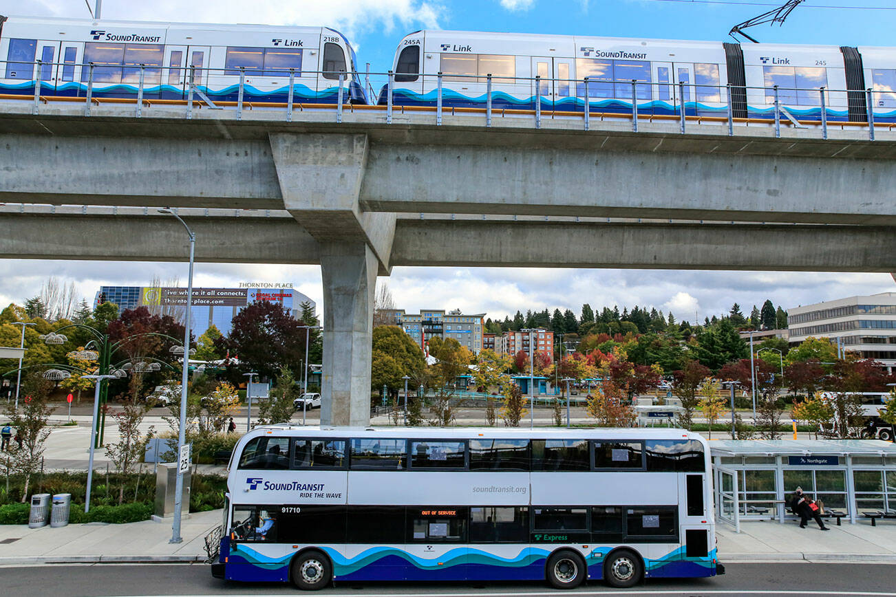 A Sound Transit bus at it's new stop in the shadow of the newly opened Northgate Lightrail Station in Seattle. (Kevin Clark / The Herald)