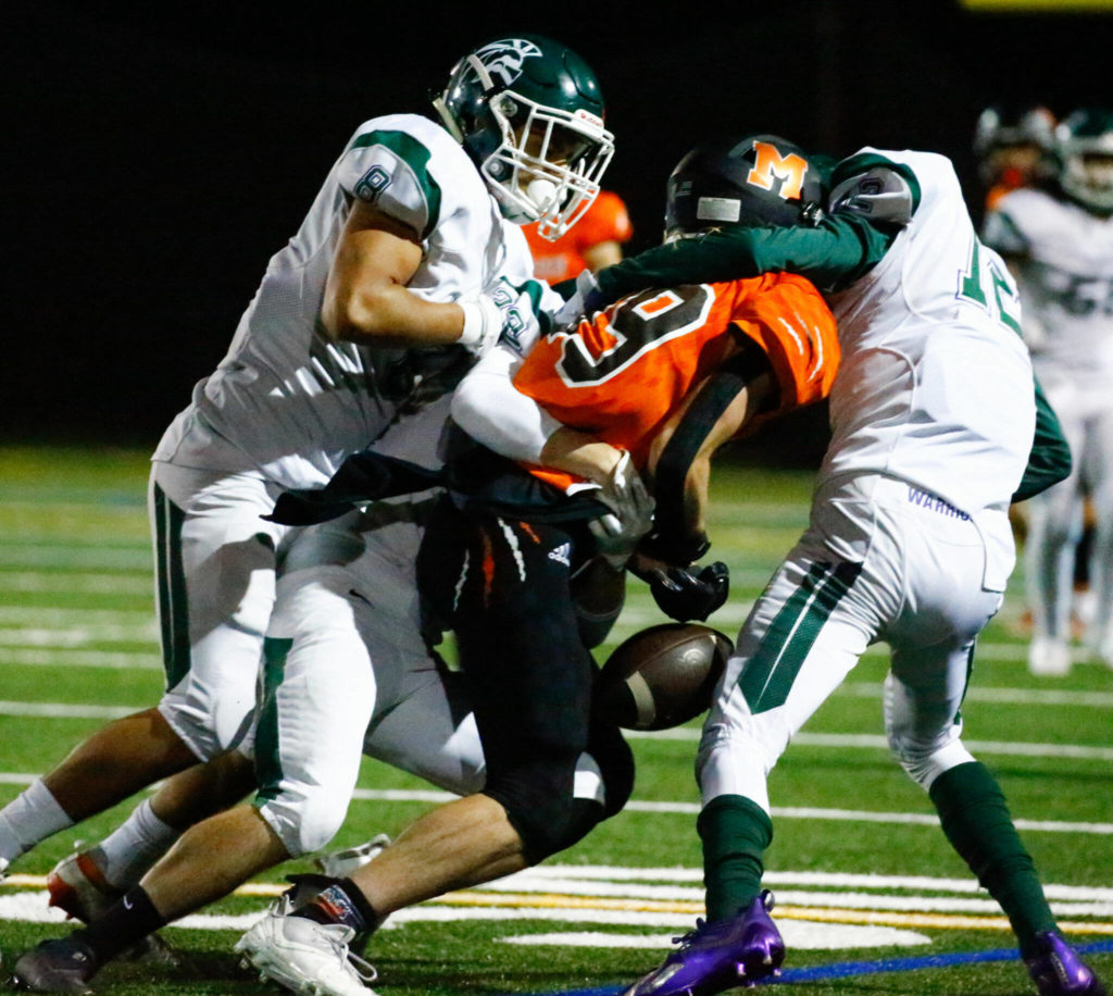 Edmonds-Woodway's defense forces a fumble Monroe's Liam O'Brian Friday night at Monroe High School on October 1, 2021. (Kevin Clark / The Herald)
