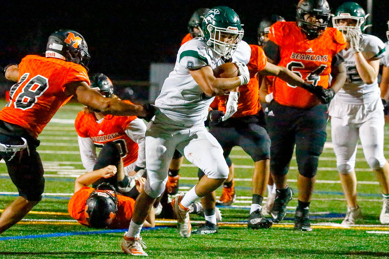 Edmonds-Woodway's Aaron Barraza rushes for the goal line a touchdown Friday night at Monroe High School on October 1, 2021.   (Kevin Clark / The Herald)