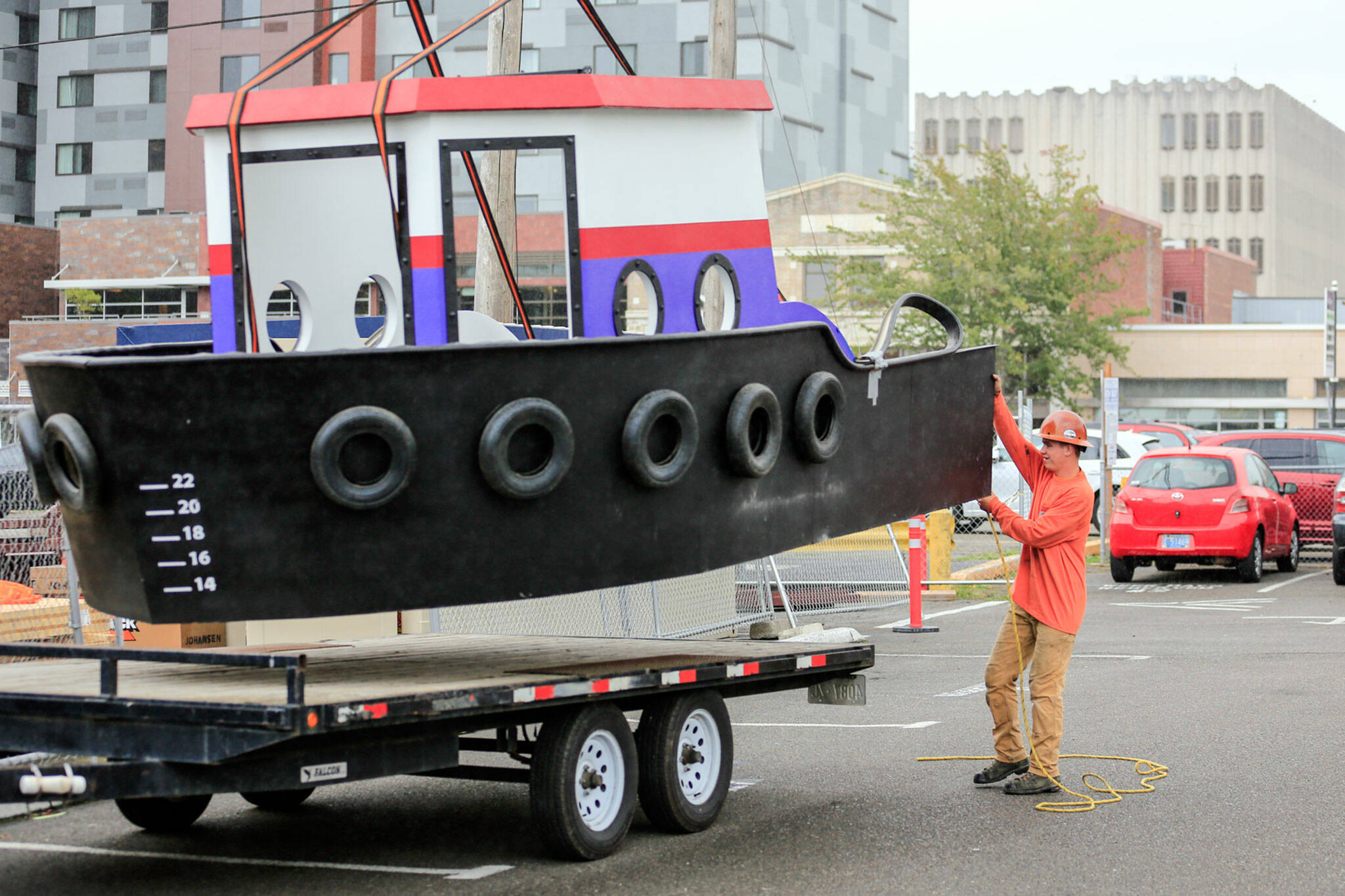 A model tugboat exhibit is hoisted Sept. 27 into the expansion of the Imagine Children's Museum in Everett. (Kevin Clark / The Herald)