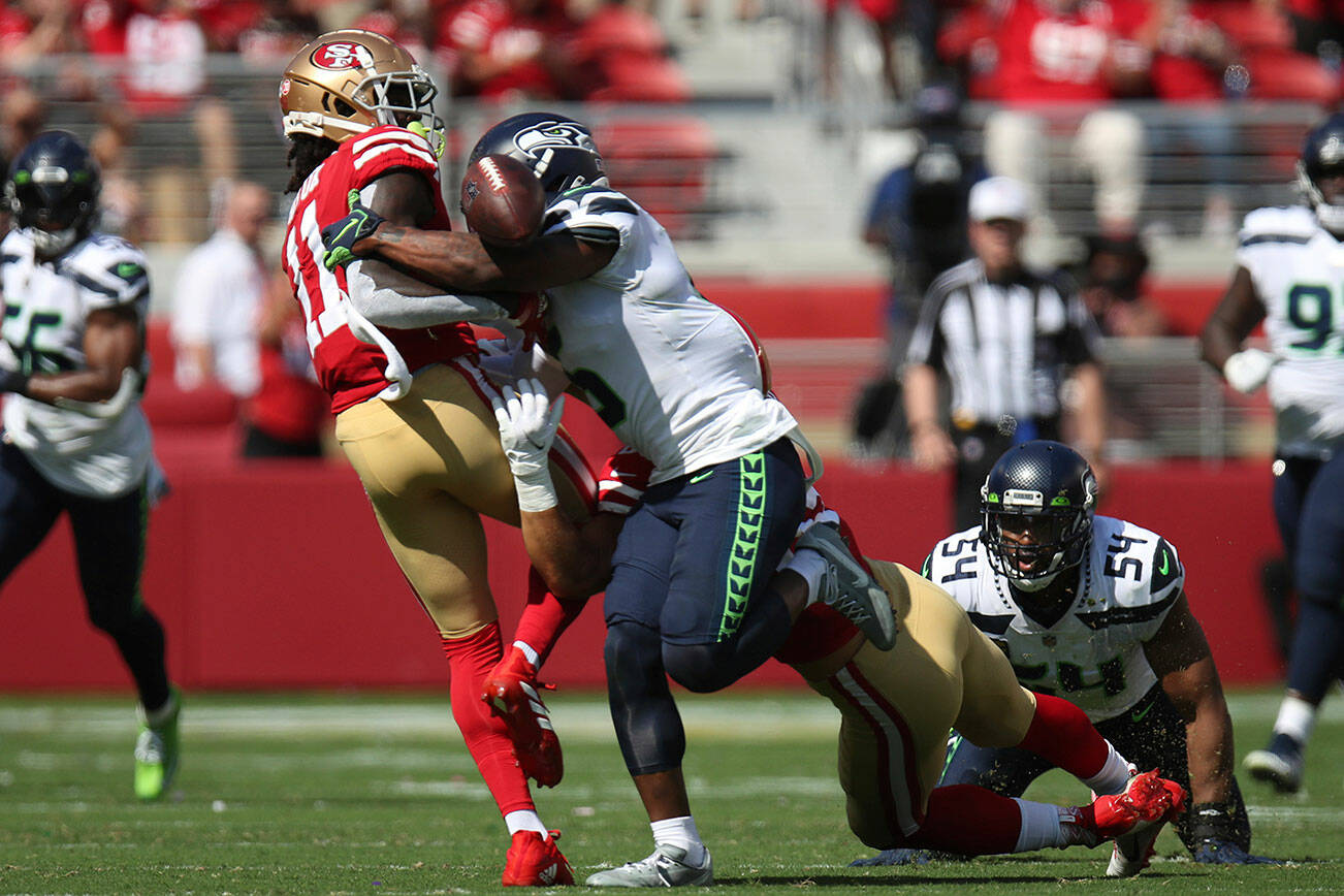 Seattle Seahawks' Quandre Diggs (6) breaks up a pass intended for San Francisco 49ers Brandon Aiyuk (11) during an NFL football game, Sunday, October 3, 2021, in Santa Clara, Calif. (AP Photo/Scot Tucker)