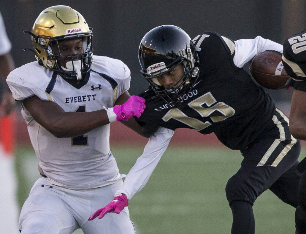 Everett's Jemyre Reed grabs Lynnwood's Andrew Archide by the jersey during a game on Friday in Edmonds. (Olivia Vanni / The Herald)
