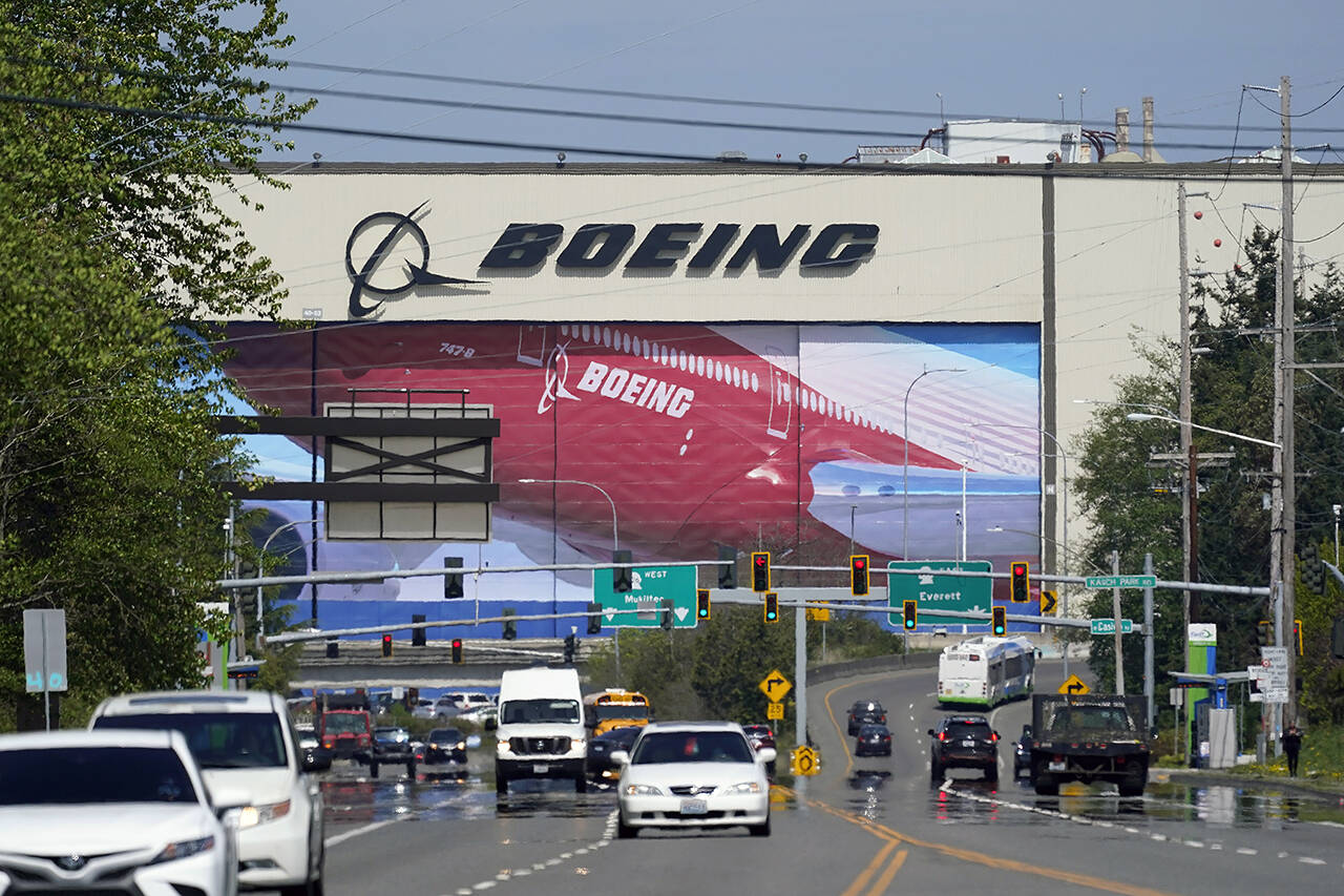 Traffic drives in view of the Boeing Co. production plant April 23 in Everett. (AP Photo/Elaine Thompson/file)