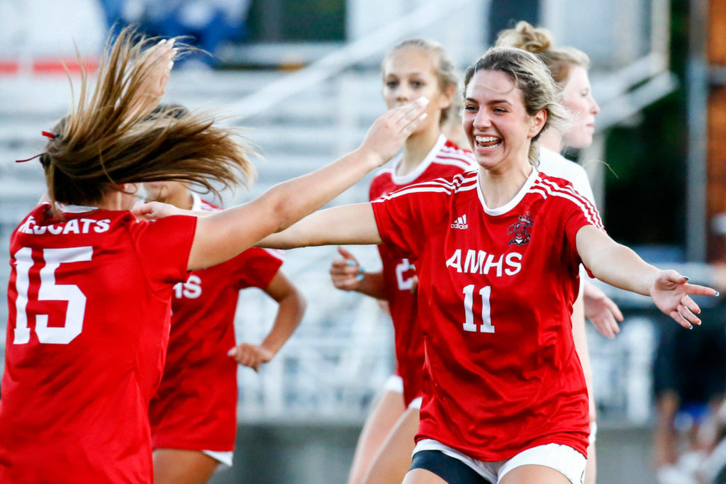 Archbishop Murphy's Taylor Campbell (right) celebrates her header goal off a corner kick from Jordyn Latta (left) during a game against Monroe on Sept. 23, 2021, at Archbishop Murphy High School in Everett. (Kevin Clark / The Herald)