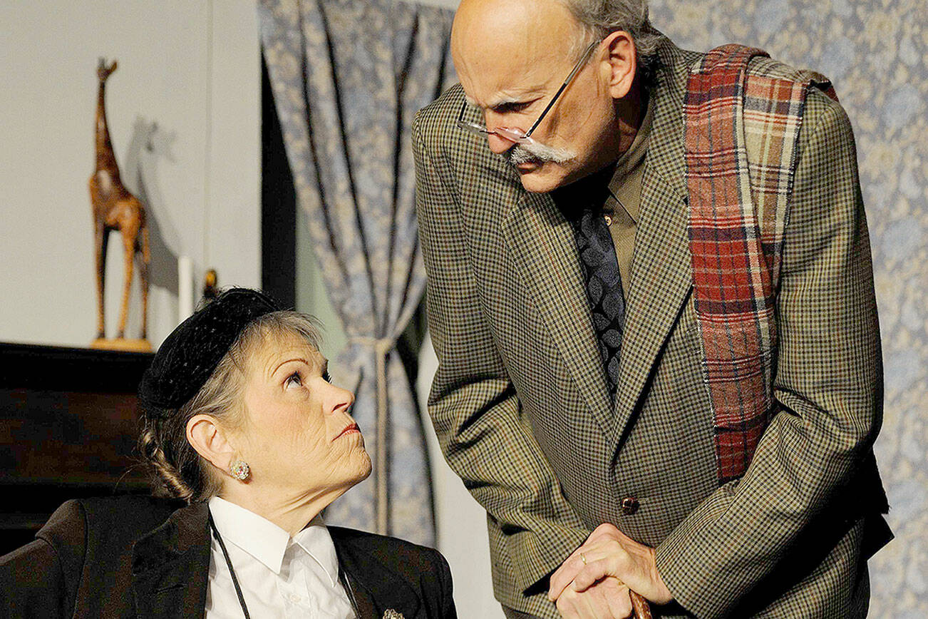 """See Dawn Cornell as Judge Laura Wargrave and Bill Kusler as Gen. John Mackenzie in Red Curtain's production of """"And Then There Were None,"""" showing at the Marysville theater through Nov. 3. (Larry T. Lisk)"""