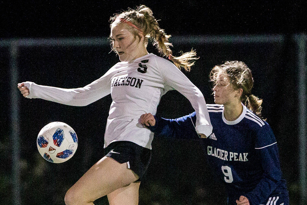 Jackson's Avery Friedricksen jumps to trap the ball during the game against Glacier Peak on Tuesday, Oct. 26, 2021 in Snohomish, Wa. (Olivia Vanni / The Herald)